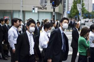 Business men wearing flu masks